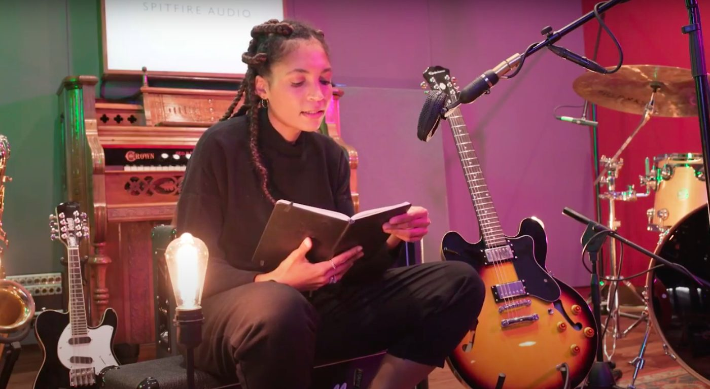 Sans Soucis reading from her journal, in a music studio