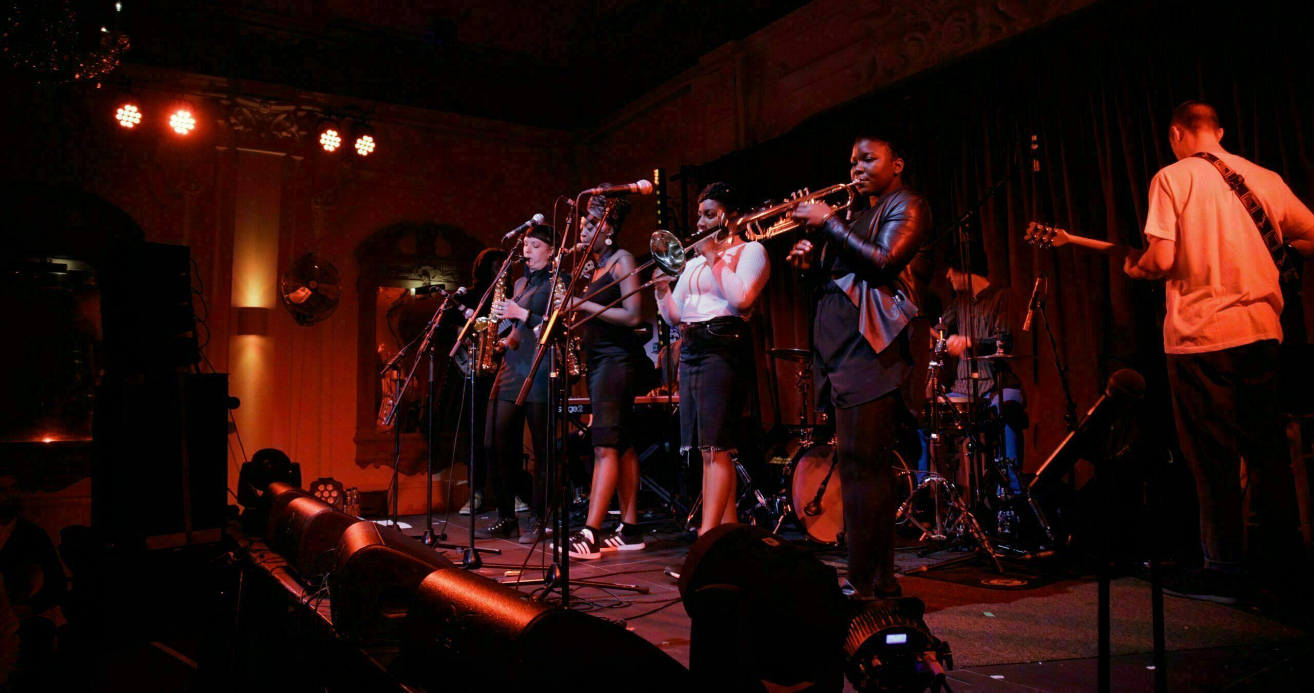 Band called Kokoroko playing a gig